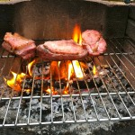 Duck breasts grilled over a walnut wood fire